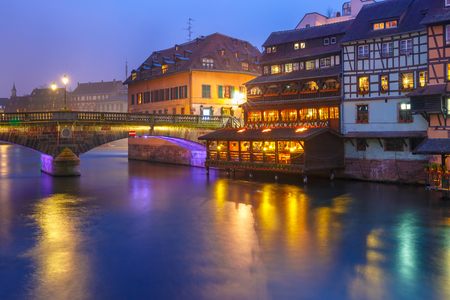 Traditional Alsatian half-timbered housesand bridge in Petite France during twilight blue hour, Strasbourg, Alsace, France