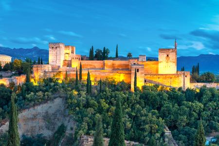 Moorish fortress Alcazaba, citadel of Alhambra, during evening blue hour in Granada, Andalusia, Spain