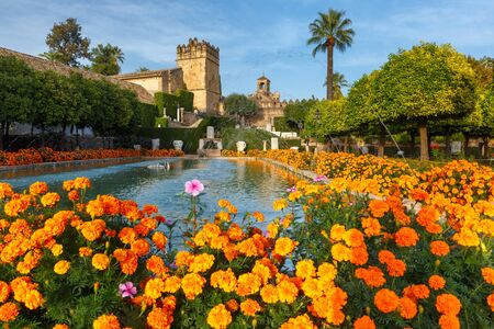 Blooming gardens and fountains of Alcazar de los Reyes Cristianos, royal palace of the cristian kings, in Cordoba, Andalusia, Spain Stock Photo