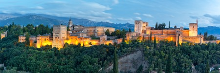 granada: Panorama of Moorish palace and fortress complex Alhambra with Comares Tower, Alcazaba, Palacios Nazaries and Palace of Charles V during evening blue hour in Granada, Andalusia, Spain Stock Photo