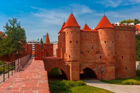 semicircular: Semicircular fortified medieval outpost Barbican in the Old Town of Warsaw in the summer sunny day, Poland Stock Photo