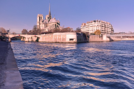 ile de la cite: Picturesque view of Ile de la Cite, Seine River and Cathedral of Notre Dame de Paris in the winter morning, France Stock Photo