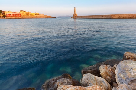 Picturesque view of old harbour with Lighthouse of Chania during morning blue hour, Crete, Greece Stock Photo