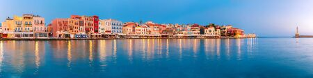 reveille: Picturesque panoramic view of old harbour with Lighthouse of Chania at sunrise, Crete, Greece
