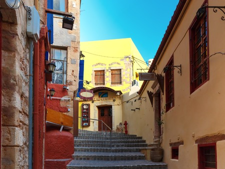 footway: Stairs to the narrow streets of the old town in the sunny morning, Chania, Crete, Greece Stock Photo