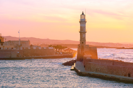 dawning: Lighthouse in old harbour of Chania at dawn, Crete, Greece