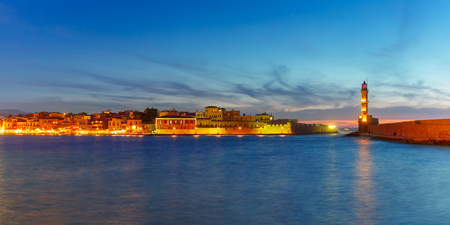 Panorama venetian harbour waterfront and Lighthouse in old harbour of Chania during twilight blue hour, Crete, Greece Stock Photo