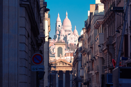 sacred heart: Sacre-Coeur Basilica or Basilica of the Sacred Heart of Jesus and Notre-Dame de Lorette church, seen from Rue Laffitte in the winter morning, Paris, France Stock Photo