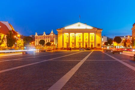 eventide: Town Hall Square in Old Town at night of Vilnius, Lithuania, Baltic states. Stock Photo