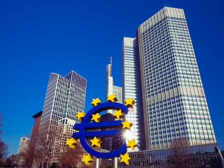 money business: Business and finance concept with giant Euro sign at European Central Bank headquarters in the morning, business district in Frankfurt am Main, Germany