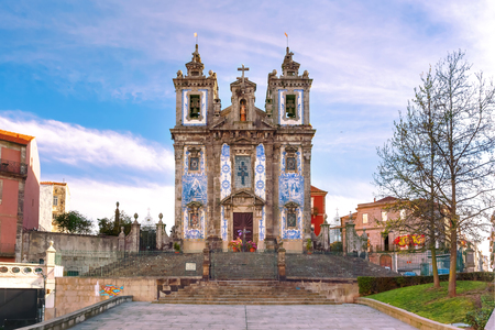 Beautiful old church of Saint Ildefonso or Igreja de Santo Ildefonso in a proto-Baroque style with facade covered with azulejos tiles in the sunny morning, Porto, Portugal