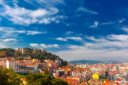 The Castle of Sao Jorge, the historical centre of Lisbon, Tagus River and 25 de Abril Bridge on the sunny afternoon, Lisbon, Portugal