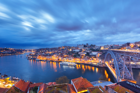 luis: Picturesque panoramic aerial view of Old town of Porto, Ribeira and Dom Luis I or Luiz I iron bridge across Douro River during evening blue hour, Portugal Stock Photo