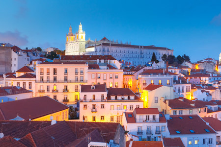 outdoor lighting: Scenic view of Alfama, the oldest district of the Old Town, with Monastery of Sao Vicente de Fora during evening blue hour, Lisbon, Portugal Stock Photo