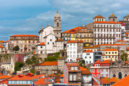 Aerial view with traditional multicolored quaint houses in Old town of Porto in the sunny day, Portugal
