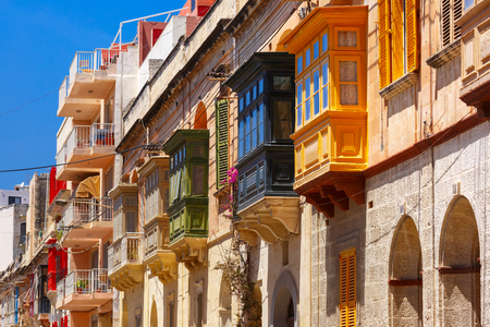 The traditional Maltese colorful wooden balconies in Sliema, Malta Stock Photo