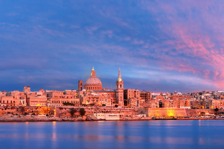Valletta Skylineat at beautiful sunset from Sliema with churches of Our Lady of Mount Carmel and St. Pauls Anglican Pro-Cathedral, Valletta, Capital city of Malta