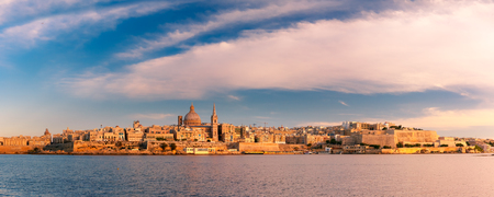 Panoramic view of Valletta Skylineat at beautiful sunset from Sliema with churches of Our Lady of Mount Carmel and St. Pauls Anglican Pro-Cathedral, Valletta, Capital city of Malta