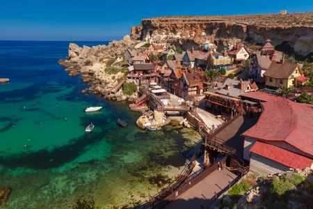 Traditional colorful houses in the Popeye Village at Anchor Bay, Il-Mellieha, Malta