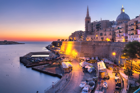 Valletta Skyline with churches of Our Lady of Mount Carmel and St. Pauls Anglican Pro-Cathedral, at dawn, Valletta, Capital city of Malta