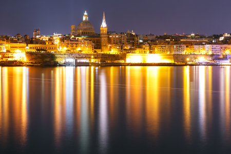 Valletta Skyline at night from Sliema with church of Our Lady of Mount Carmel and St. Pauls Anglican Pro-Cathedral, Valletta, Capital city of Malta