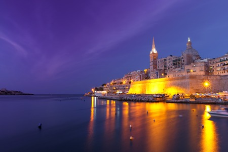 Valletta Skyline at night with church of Our Lady of Mount Carmel and St. Pauls Anglican Pro-Cathedral, Valletta, capital city of Malta