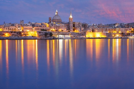 st pauls: Valletta Skyline from Sliema with church of Our Lady of Mount Carmel and St. Pauls Anglican Pro-Cathedral during evening blue hour, Valletta, Capital city of Malta
