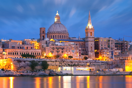 Valletta Skyline from Sliema with church of Our Lady of Mount Carmel and St. Pauls Anglican Pro-Cathedral during evening blue hour, Valletta, Capital city of Malta