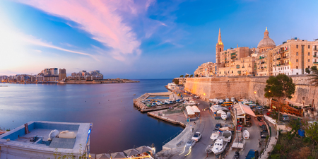 Valletta panoramic Skyline with church of Our Lady of Mount Carmel and St. Pauls Anglican Pro-Cathedral, at beautiful sunset, Valletta, Capital city of Malta