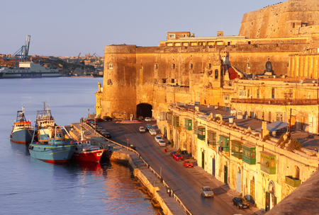 Lascaris Battery, with the Saluting Battery and the Upper Barrakka Gardens, Church of Our Lady of Liesse and Quay of Valletta at dawn, Malta.