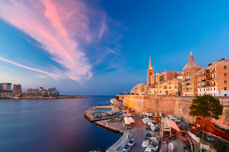Valletta Skyline with church of Our Lady of Mount Carmel and St. Pauls Anglican Pro-Cathedral, at beautiful sunset, Valletta, Capital city of Malta