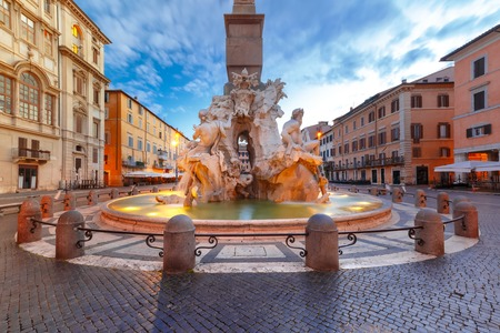 morning blue hour: Fountain of the Four Rivers on the famous Piazza Navona Square during morning blue hour, Rome, Italy.