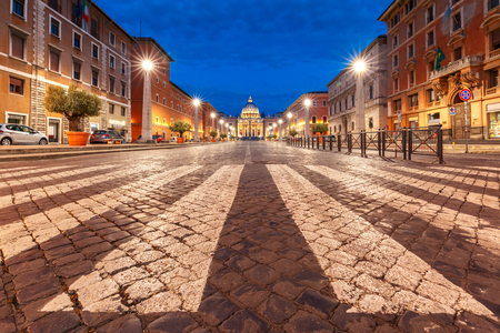 View of The Papal Basilica of St. Peter in the Vatican or Saint Peter Cathedral during morning blue hour in Rome, Italy. Stock Photo
