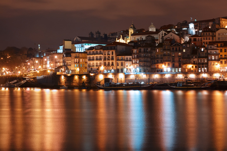 picturesque: Ribeira and Old town of Porto with mirror reflections in the Douro River at night, Portugal, Portugal.