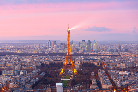 26: Paris, France - December 26, 2016: Aerial view of Paris skyline with Shimmering Eiffel Tower and business district of Defense at pink sunset, as seen from Montparnasse Tower Editorial