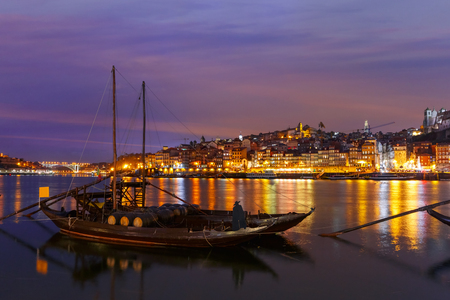 rabelo: Traditional rabelo boats with barrels of Port wine on the Douro river and Old Town, Porto, Portugal.