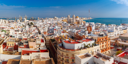 Aerial panoramic view of the old city rooftops and Cathedral de Santa Cruz in the morning from tower Tavira in Cadiz, Andalusia, Spain