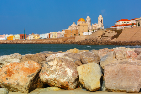 Playa de la Santamaria beach and Cathedral de Santa Cruz in the morning in Cadiz, Andalusia, Spain Stock Photo