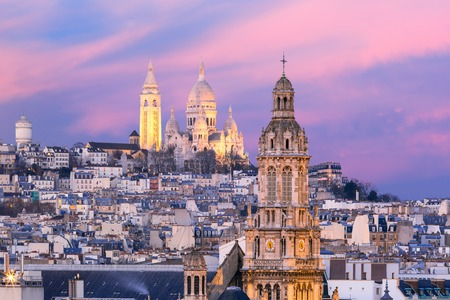 Aerial view of Sacre-Coeur Basilica or Basilica of the Sacred Heart of Jesus at the butte Montmartre and Saint Trinity church at nice sunset, Paris, France Standard-Bild
