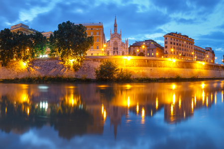 Tiber riverside with Church of the Sacred Heart of Jesus in Prati and mirror reflection during evening blue hour in Rome, Italy Stock fotó