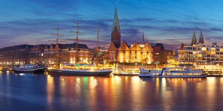 Embankment of the Weser River and Protestant Lutheran Saint Martin Church in the old town of Bremen, Germany. Night panoramic view. Stock Photo