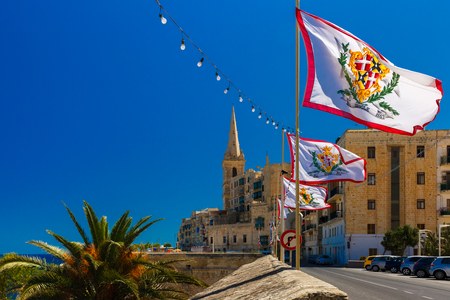 feast: Festively decorated street with flags of all the Grand Masters of the Sovereign Military Order of Malta in the old town of Valletta, Malta