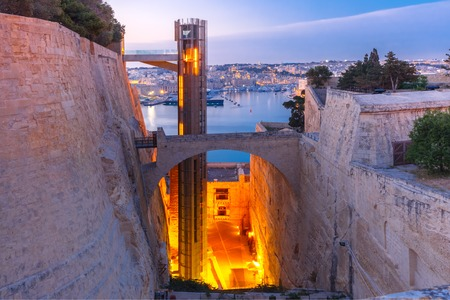 Upper Barrakka Lift, from Grand Harbour to Upper Barrakka Gardens, during morning blue hour, Valletta, Malta