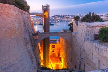 Upper Barrakka Lift, from Grand Harbour to Upper Barrakka Gardens, during morning blue hour, Valletta, Malta