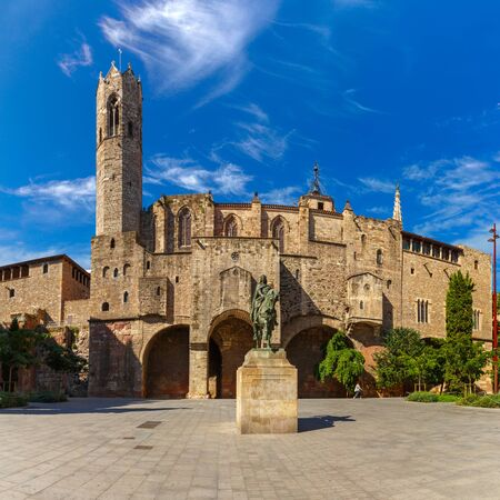 noon: Statue of Ramon Berenguer III on square Placa Ramon Berenguer the Great, Capella de Santa Agata and Roman wall on background, Barri Gothic Quarter in Barcelona, Catalonia, Spain
