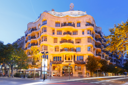 Barcelona, Catalonia, Spain - July 7, 2017: Casa Mila better known as La Pedrera during evening blue hour, it is the last private residence designed by architect Antoni Gaudi