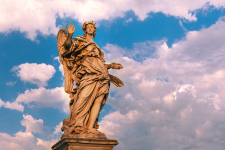 Marble statue of Angel with the Nails at sunset, one of the ten angels on Saint Angel Bridge, symbols of Christs Passion, Rome, Italy