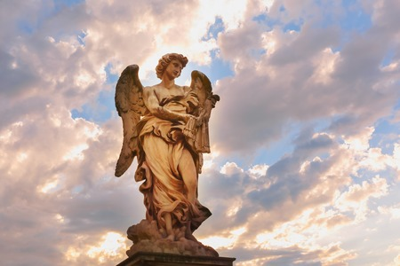 Marble statue of Angel with the Whips at sunset, one of the ten angels on Saint Angel Bridge, symbols of Christs Passion, Rome, Italy