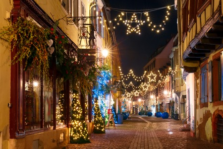 Traditional Alsatian half-timbered houses in old town of Colmar, decorated and illuminated at christmas time, Alsace, France Stock Photo