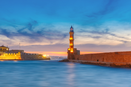 Panorama venetian harbour waterfront and Lighthouse in old harbour of Chania at sunset, Crete, Greece Stock Photo